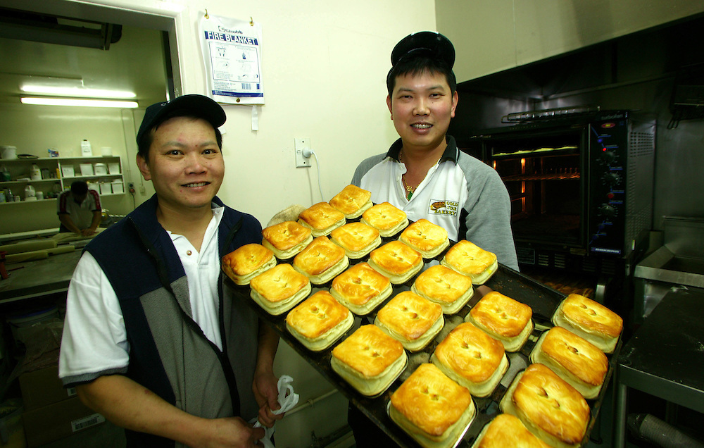 Supreme pie makers of New Zealand for 2003 and 2004 brothers Mark, left and Patrick Lam with some of their award winning pies at their bakery in Rotorua,  New Zealand, November 11, 2005. The brothers arrived in New Zealand as refugees from Cambodia. Credit:SNPA / Rob Tucker