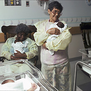 RSVP : Retired Senior Volunteer Program, in hospital nursery, holding boarder (crack) baby, Lincoln Hospital's nursey pediatric ward in the South Bronx, NY