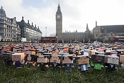 © licensed to London News Pictures. 04/03/2013. London, UK. Photocall for 6,000 personalised cardboard characters placed on Parliament square, London, in front of the houses of Parliament as part of the Fairtrade Foundation's campaign for a better deal for<br />