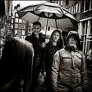 Walking in the rain with an umbrella. Amsterdam, The Netherlands