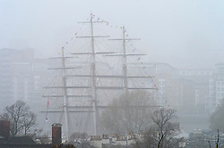 © Licensed to London News Pictures. 07/04/2019.<br /> Greenwich, UK.A misty view of the Cutty Sark from Greenwich Park. A foggy damp morning in London and the South East as people are out and about in Greenwich Park, Greenwich, London.  Photo credit: Grant Falvey/LNP