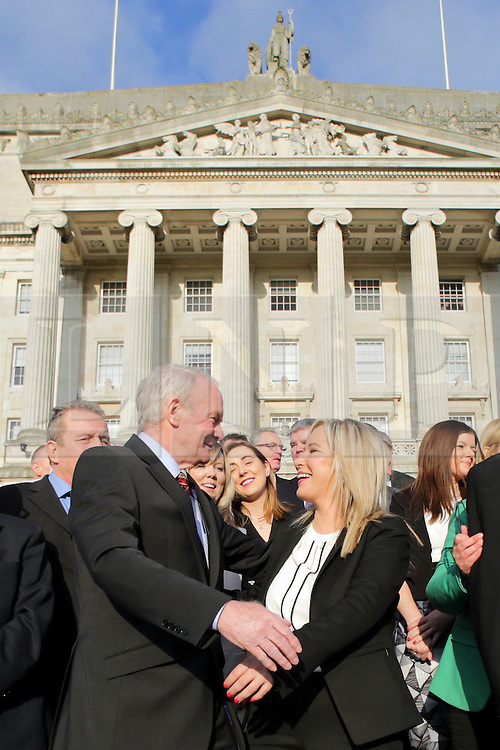 © Licensed to London News Pictures. STORMONT BELFAST - 23 JAN 2017: Sinn Fein's Michelle O'Neill (centre) gets a hug from Martin McGuinness, on the steps of Stormont after being named as the new leader of Sinn Fein in the North, taking over from former deputy first minister Martin McGuinness who has retired due to illness. Photo credit: London News Pictures.