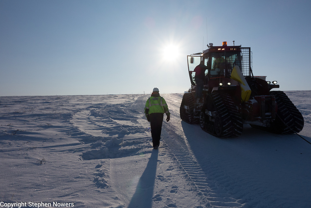 A Cruz Construction steiger prepares to get underway on a snow trail from the Dalton Highway to Umiat during the 2013-2014 winter drilling season. Cruz Construction provided rig support for Linc Energy's drilling program in Umiat.
