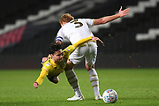 Coventry City midfielder (on loan from Aston Villa) Callum O'Hare (17) `is fouled by Milton Keynes Dons defender Dean Lewington (3) during the EFL Trophy match between Milton Keynes Dons and Coventry City at Stadium:MK, Milton Keynes, England on 3 December 2019.