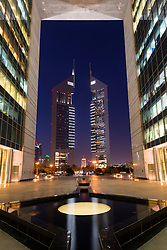 Night view of Emirates Towers from The Gate at DIFC or Dubai International Finacial Center  in Dubai United Arab Emirates