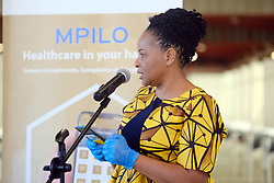 JOHANNESBURG, SOUTH AFRICA - APRIL 25: MTN Foundation Head Kusile Mtunzi discussing the donation of smart devices at a handover by various stakeholders at the Nasrec quarantine site currently under construction. With isolation units, consultation areas, ICU capabilitiies, medical facilities, power points, drainage and ablutions, the quarantine site will have a total bed capacity of 2300 on April 25, 2020 in Johannesburg South Africa. Under pressure from a global pandemic. President Ramaphosa declared a 21 day national lockdown extended by another two weeks, mobilising goverment structures accross the nation to combat the rapidly spreading COVID-19 virus - the lockdown requires businesses to close and the public to stay at home during this period, unless part of approved essential services. (Photo by Dino Lloyd)
