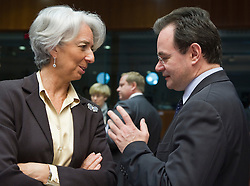 Christine Lagarde, France's finance minister, left, speaks with George Papaconstantinou, Greece's finance minister, during the meeting of European Union finance ministers in Brussels, Belgium, on Tuesday, May 18, 2010. (Photo © Jock Fistick)