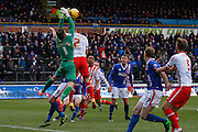 Carlisle United Goalkeeper Mark Gillespie and Stevenage FC Defender Luke Wilkinson attack the ball during the Sky Bet League 2 match between Carlisle United and Stevenage at Brunton Park, Carlisle, England on 20 February 2016. Photo by Craig McAllister.