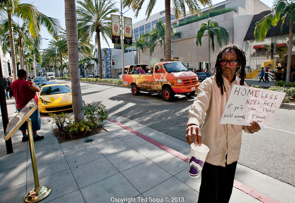 A homeless man begging on Rodeo Drive in Beverly Hills.