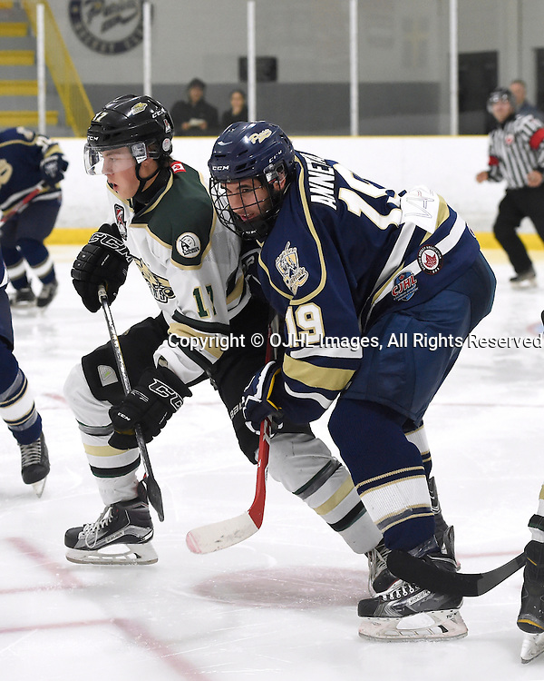 TORONTO, ON - OCT 8,  2016: Ontario Junior Hockey League game between Cobourg and Toronto, Brenden Locke #17 of the Cobourg Cougars battles for control with Giusten Annetta #19 of the Toronto Patriots during the second period.<br /> (Photo by Andy Corneau / OJHL Images)