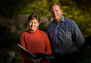 """Author Paula Pepper with developer Randy Sater stand in the backyard of Paula's home as she holds the book she wrote. StoneBridge Properties, the home-building arm of Teichert Construction, is master planning 4,000 acres off of Jackson Hwy. for a new community called New Brighton. This area has its roots in Brighton Township, one of Sacramento's historic townships. Before breaking ground, developer Randy Sater commissioned local historian Paula Pepper to write a book about the area. The result is """"Brighton Township: Stories of the Land, """" a beautifully illustrated tribute to this township's past that brings up several key points in planning the area's future. November 16, 2009."""