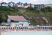 People enjoying Sunny Sands beach, Folkestone, Kent.