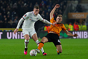 Herbie Kane of Hull City goes in for a slide tackle on Ross Barkley of Chelsea during the The FA Cup match between Hull City and Chelsea at the KCOM Stadium, Kingston upon Hull, England on 25 January 2020.