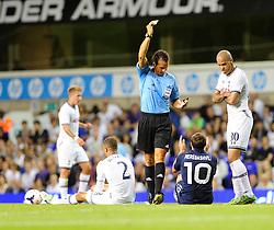 Dinamo Tbilisi's Giorgi Merebashvili receives a yellow card after fouling Tottenham Hotspur's Kyle Walker  - Photo mandatory by-line: Dougie Allward/JMP - Tel: Mobile: 07966 386802 27/08/2013 - SPORT - FOOTBALL - White Hart Lane - London - Tottenham Hotspur V Dinamo Tbilisi -  UEFA EUROPA LEAGUE - PLAY-OFF - SECOND LEG