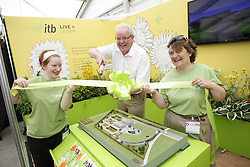 "Repro Free: 30/05/2013 ""Sowing its seeds for the future if Horticulture Education"" Larry McNutt Head of School of Informatics at ITB is pictured cutting the ribbon on Institute of Technology Blanchardstown Gold Medal Educational Stand at Bloom where they unveiled the plans for their new ?1m on campus Horticulture Facility. Picture Andres Poveda"