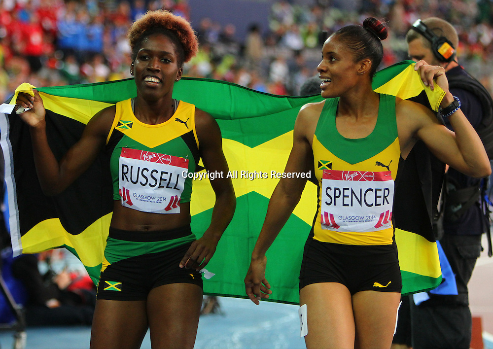 31.07.2014. Glasgow, Scotland. Glasgow Commonwealth Games. Women's 400m Hurdles final from Hampden Park. Kaliese Spencer and Janieve Russell of Jamaican won Gold and Bronze