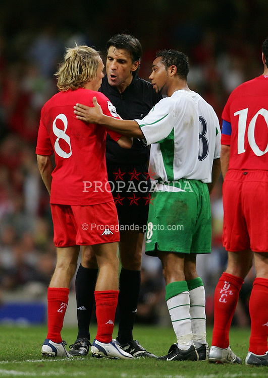 CARDIFF, WALES - Wednesday, September 8, 2004: Wales' Craig Bellamy argues with Northern Ireland's Jeff Whitley during the Group Six World Cup Qualifier at the Millennium Stadium. (Pic by David Rawcliffe/Propaganda)
