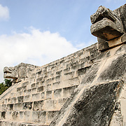 Stone stairs at Chichen Itza with jaguar heads on either side. The Jaguar is a recurring symbol in Mayan culture.