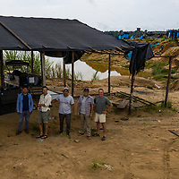 An aerial drone photograph of the CINCIA drone team with photographer Jason Houston. Following Peru's February 2019 militarized crackdown on illegal and unofficial alluvial gold mining in the La Pampa region of Madre de Dios, Wake Forest University's Puerto Maldonado-based Centro de Innovación Científica Amazonia (CINCIA), a leading research institution for the development of technological innovation for biological conservation and environmental restoration in the Peruvian Amazon, is applying years of scientific research and technical experience related to understanding mercury contamination and managing Amazonian ecosystems. What they learn will help guide urgent remediation, restoration, and reforestation efforts that can also serve as models for how we address the tropic's most dramatically devastated landscapes around the world. La Pampa, Madre de Dios, Peru.