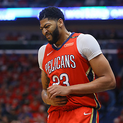 Apr 19, 2018; New Orleans, LA, USA; New Orleans Pelicans forward Anthony Davis (23) grimaces as he grabs his hand during the first quarter in game three of the first round of the 2018 NBA Playoffs against the Portland Trail Blazers at the Smoothie King Center. Mandatory Credit: Derick E. Hingle-USA TODAY Sports