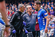 Rangers physios give Nikola Katic of Rangers FC the once over during the Ladbrokes Scottish Premiership match between Rangers and Aberdeen at Ibrox, Glasgow, Scotland on 27 April 2019.