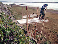 Ron Austing building a Peregrine Falcon blind in Bathurst Inlet; Nunavut Territory; Canada