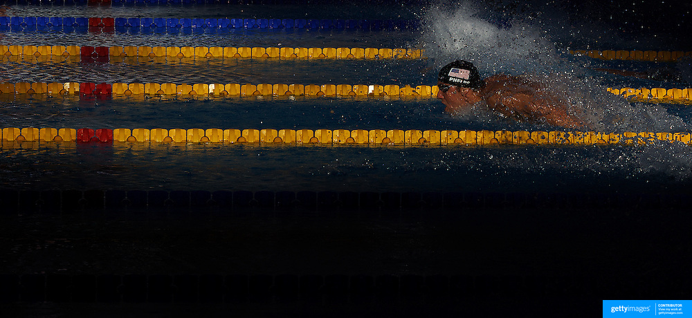 The late evening Roman Sunshine catches Michael Phelps, USA, on his way to winning gold in a new world record time in the Men's 200m Butterfly final at the World Swimming Championships in Rome on Wednesday, July 29, 2009. Photo Tim Clayton.