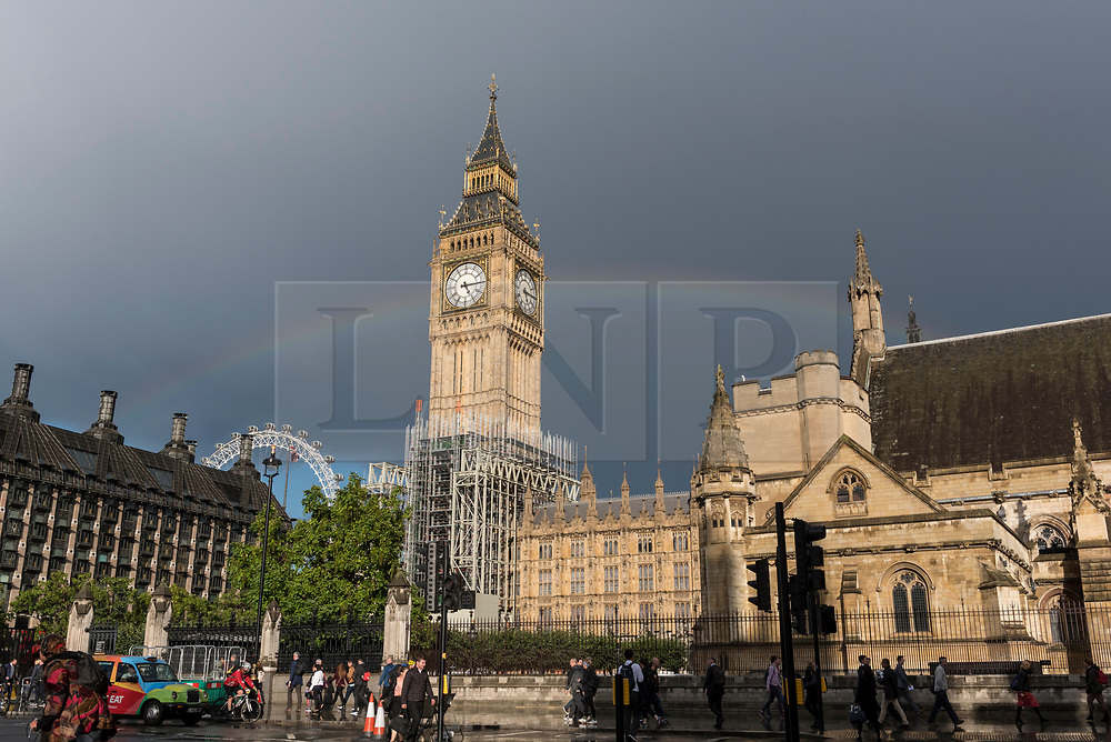 © Licensed to London News Pictures. 11/09/2017. London, UK. After a heavy rain shower in the capital, a rainbow is seen behind the Queen Elizabeth Tower, commonly known Big Ben. Photo credit : Stephen Chung/LNP