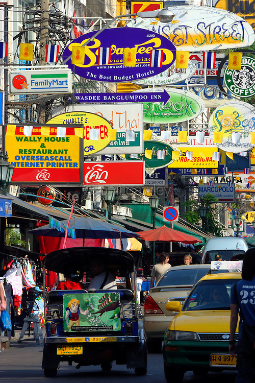 Brightly coloured signs on Khao San Road, Bangkok Thailand Asia