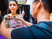25 MARCH 2015 - BANGKOK, THAILAND: A contestant gets her Miss Tiffany's badge before the first round of the Miss Tiffany's contest at CentralWorld, a large shopping mall in Bangkok. Miss Tiffany's Universe is a beauty contest for transgender contestants; all of the contestants were born biologically male. The final round will be held on May 8 in the beach resort of Pattaya. The final round is televised of the  Miss Tiffany's Universe contest is broadcast live on Thai television with an average of 15 million viewers.      PHOTO BY JACK KURTZ