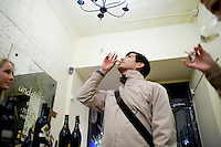 2 December, 2008. New York, NY. Basil Reyes, 37, tastes a glass of Sherry at the Tinto Fino spanish wine shop. The Tinto Fino spanish wine shop organizes a sherry tasting. Sherry is a fortified wine made from white grapes that are grown near the town of Jerez, Spain. In Spanish, it is called Vino de Jerez.<br /> <br /> ©2008 Gianni Cipriano for The New York Times<br /> cell. +1 646 465 2168 (USA)<br /> cell. +1 328 567 7923 (Italy)<br /> gianni@giannicipriano.com<br /> www.giannicipriano.com