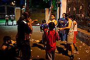 Razia Shabnam (left, in dark blue) conducts a training session in Biyam Samiti park with children from the area of Kidderpore, Calcutta, West Bengal, India. Razia Shabnam, 28, was one of the first women boxers in Kolkata. She was also the first woman in her community to go to college. She is now a coach and one of only three international female boxing referees in India.  Photo by Suzanne Lee for Panos London