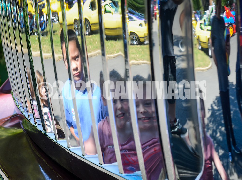 From left, Rosa Antonio, 3, Angel Antonio, 5 and Riley Weiser, 5 of Levittown, Pennsylvania are reflected in the grill of a 2006 Ford F350 during a car show presented by Bucks County Stangz at the Bucks County Senior Center Saturday August 27, 2016 in Morrisville, Pennsylvania.  (Photo by William Thomas Cain)