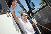 "June 13 - PHOENIX, AZ: ROBERT LUNA, from Anaheim, CA, dressed as US President Barrack Obama waves to the crowd as he gets off a bus in Phoenix before an immigrants' rights rally and vigil. About 40 immigrants' rights activists from Anaheim, California, joined Phoenix area activists at the Arizona State Capitol Sunday for a prayer vigil and rally against SB 1070, the Arizona law that gives local law enforcement agencies the power to ask to see proof of immigration status in the course of a ""lawful contact"" and when ""practicable."" Immigrants' rights and civil rights activist say the bill will lead to racial profile. Proponents of the bill say it is the toughest local anti-immigration bill in the country and merely brings state law into line with federal immigration law.  The law, which was signed by the Arizona Governor in April, goes into effect on July 29, 2010.   Photo by Jack Kurtz"