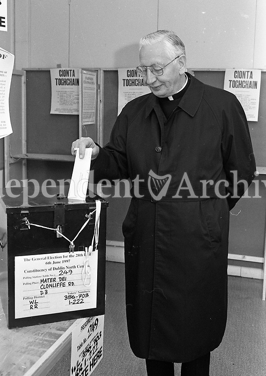 Archbishop of Dublin Most Rev Dr Desmond Connell casting his vote in the General Election at Mater Dei, Clonliffe Road, 06/06/1996 (Part of the Independent Newspapers Ireland/NLI Collection).