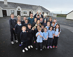 Ballintubber's Alan Plunkett with the pupils of Killawalla National School<br /> where he attends on a weekly basis as a resource teacher.<br /> Pic Conor McKeown