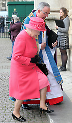 The Queen is greeted by The Very Reverend Dr John Hall Dean of Westmintser as she arrives at the annual Commonwealth Observance at Westminster Abbey in London, Monday, 10th March 2014. Picture by Stephen Lock / i-Images