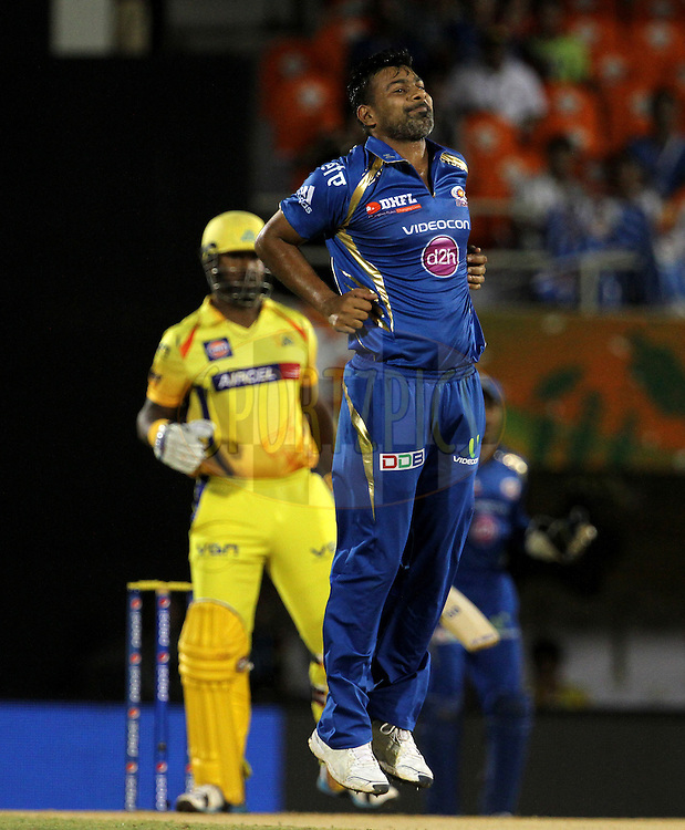 Praveen Kumar of the Mumbai Indians reacts during the eliminator match of the Pepsi Indian Premier League Season 2014 between the Chennai Superkings and the Mumbai Indians held at the Brabourne Stadium, Mumbai, India on the 28th May  2014<br /> <br /> Photo by Vipin Pawar / IPL / SPORTZPICS<br /> <br /> <br /> <br /> Image use subject to terms and conditions which can be found here:  http://sportzpics.photoshelter.com/gallery/Pepsi-IPL-Image-terms-and-conditions/G00004VW1IVJ.gB0/C0000TScjhBM6ikg