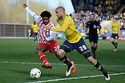 Stevenage striker Bradley Pritchard tracks Oxford forward Jordan Bowery during the Sky Bet League 2 match between Oxford United and Stevenage at the Kassam Stadium, Oxford, England on 25 March 2016. Photo by Alan Franklin.
