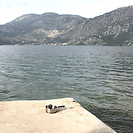 On Perast beach. There are several arguments about the derivation of the name  &quot;Montenegro&quot;, one of these relates to dark and deep forests  that once covered the Dinaric Alps, as it was possible to see them from the sea. <br /> Mostly mountainous with 672180 habitants on an area of 13812 Km&sup2;, with a population density of  48 habitants/Km&sup2;. <br /> It borders with Bosnia, Serbia, Croatia, Kosovo and Albania but  Montenegro has always been alien to the bloody political events that characterized Eastern Europe in recent decades. <br /> From 3 June 2006, breaking away from Serbia, Montenegro became an independent state. <br /> In the balance between economy devoted to sheep farming and a shy tourist, mostly coming from Bosnia and Herzegovina, Montenegro looks to Europe with a largely unspoiled natural beauty. <br /> Several cities in Montenegro, as well as the park Durmitor, considered World Heritage by UNESCO but not yet officially because Montenegro has yet to ratify the World Heritage Convention of UNESCO.