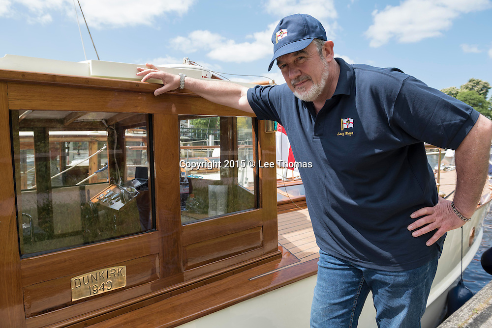 Teddington, London, UK. 16th May 2015.  Pictured: Kevin Finn, from Manchester and owner of Lazy Days, proudly presents his historic boat at Teddington Locks before he and other members of the flotilla sets off down the Thames on the first stage of their journey to the Royal Docks in east London. A team of 5 workers have spent the last 2 years restoring Lazy Days at Windsor. /<br /> During Dunkirk, Lazy Days spent three days carrying troops from East Beach whilst dodging fierce air attack. She returned to England with many of her ribs broken at the waterline. After Dunkirk, while on parachute mine patrol, a mutiny occurred. Her Petty Officer took exception to a young Lieutenant who came aboard when she was duty boat. The PO had one too manypints at lunchtime and when the young Lieutenant asked him about the course he was steering, he hit him. He was sentenced at a Chatham Court Martial to 90 days in the glasshouse. But while being escorted from Chatham to Bristol, he escaped from his escort and disappeared./ Approximately 18 Dunkirk Little Ships will set off from Teddington to France to commemorate the 75th Anniversary of Operation Dynamo in World War Two. Invited by the Mayor of Dunkirk, The Association of Dunkirk Little Ships has organised the event every 5 years since 1970 with this year likely to be the biggest return yet for the vessels now on average being close to 80 years old. Today (Saturday 16th May) the Little Ships set off to the Royal Docks in east London where a weekend of festivities will commemorate Operation Dynamo with departure for Ramsgate from Queenborough planned for Tuesday 19th May. The morning of the 21st of May (pending suitable weather conditions) sees the passage to Dunkirk, with vessels crossing one of the busiest shipping lanes in the world. It is expected that over 50 Little Ships escorted by the RNLI and the Royal Navy will take part in the Return.  // Lee Thomas, Flat 47a Park East Building, Bow Quarter, London, E3 2UT. Tel. 077841429