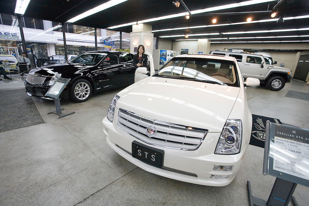 """General Motors in Japan.""""the  toughest job in japan""""  sales of GM cars in Japan  have  declined in recent years with only about 6000 units being sold last year...Tokyo showrooms  on is a cadillac one  car showroom in central tokyo  the other is  the Japanese distributors Main showroom showing  several GM models including CADILLAC  SABB  and HUMMER.."""