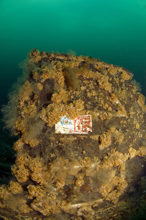 A sign from the Norwegian Sea Rescue Foundation on a sunken boat. Location : Stavanger, Norway
