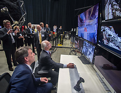May 3, 2017 - Greenbelt, MD, United States of America - His Majesty The King of Sweden King Carl XVI Gustaf, center, tries his hand at operating a remote robotic arm under the watchful eye of Benjamin Reed, Deputy Division Director of the Satellite Servicing Projects Division during a visit by a Swedish Delegation to the Goddard Space Flight Center May 3, 2017 in Greenbelt, Maryland. (Credit Image: © Bill Hrybyk/Planet Pix via ZUMA Wire)