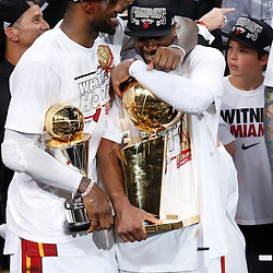 Jun 20, 2013; Miami, FL, USA; Miami Heat small forward LeBron James (left) and Dwyane Wade (right) celebrate after game seven in the 2013 NBA Finals at American Airlines Arena. Miami defeated the San Antonio Spurs 95-88 to win the NBA Championship. Mandatory Credit: Derick E. Hingle-USA TODAY Sports