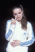 UK Grime/Garage mc Lady Sovreign, posing in gold rings and adidas tracksuit top, UK 2005