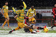 Yeovil Midfielder Iffy Allen challenged during the Sky Bet League 2 match between Morecambe and Yeovil Town at the Globe Arena, Morecambe, England on 16 January 2016. Photo by Pete Burns.
