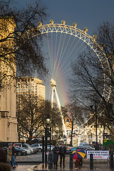 London, December 8th 2015. In the gradually settling weather in the wake of storm Desmond, an afternoon shower leaves behind a vivid rainbow with the London Eye in the foreground.. ///FOR LICENCING CONTACT: paul@pauldaveycreative.co.uk TEL:+44 (0) 7966 016 296 or +44 (0) 20 8969 6875. ©2015 Paul R Davey. All rights reserved.