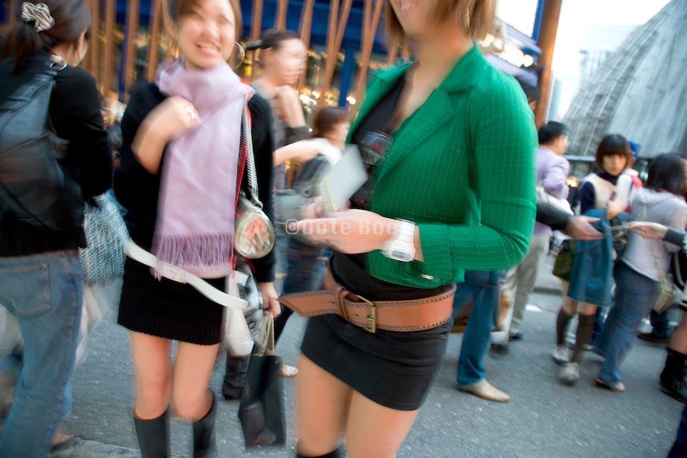 young girls meeting up in Shibuya district of Tokyo Japan