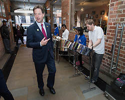 © Licensed to London News Pictures . 04/07/2014 . Leeds , UK . The Deputy Prime Minister , NICK CLEGG MP , in Leeds today (Friday 4th July 2014) , greeted by a steel band . The Liberal Democrat leader and MP for Sheffield Hallam delivers a speech on economic growth and discusses plans to develop a northern economic hub to rival London at the Carriage Works conference venue . Photo credit : Joel Goodman/LNP